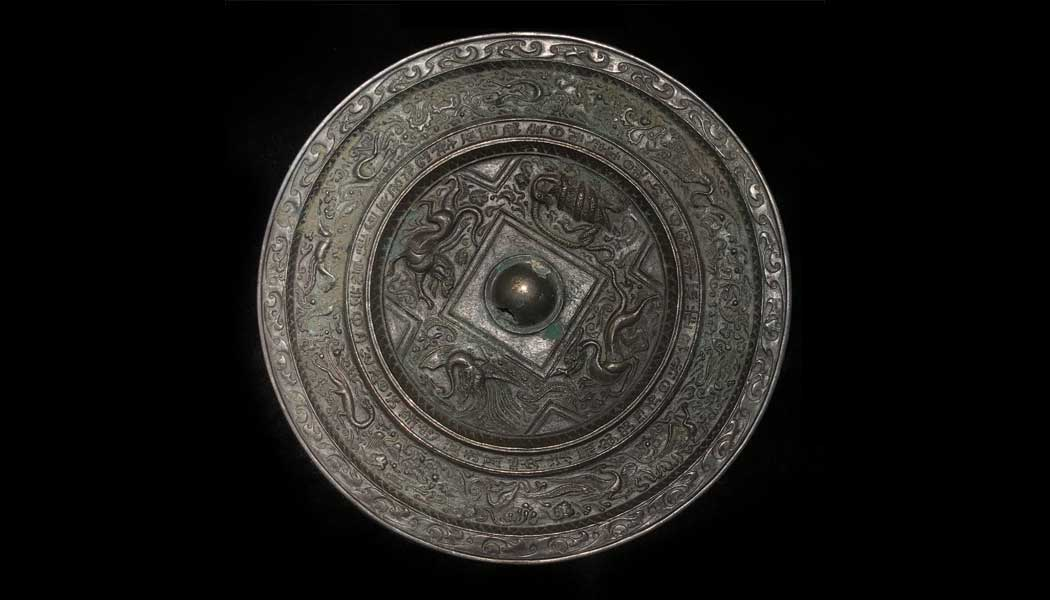 Silvered Bronze Mirror Depicting the Four Directions